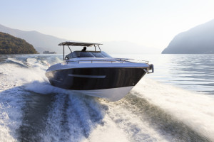 A speed boat driver cruising the open water thanks to an effective boat loan